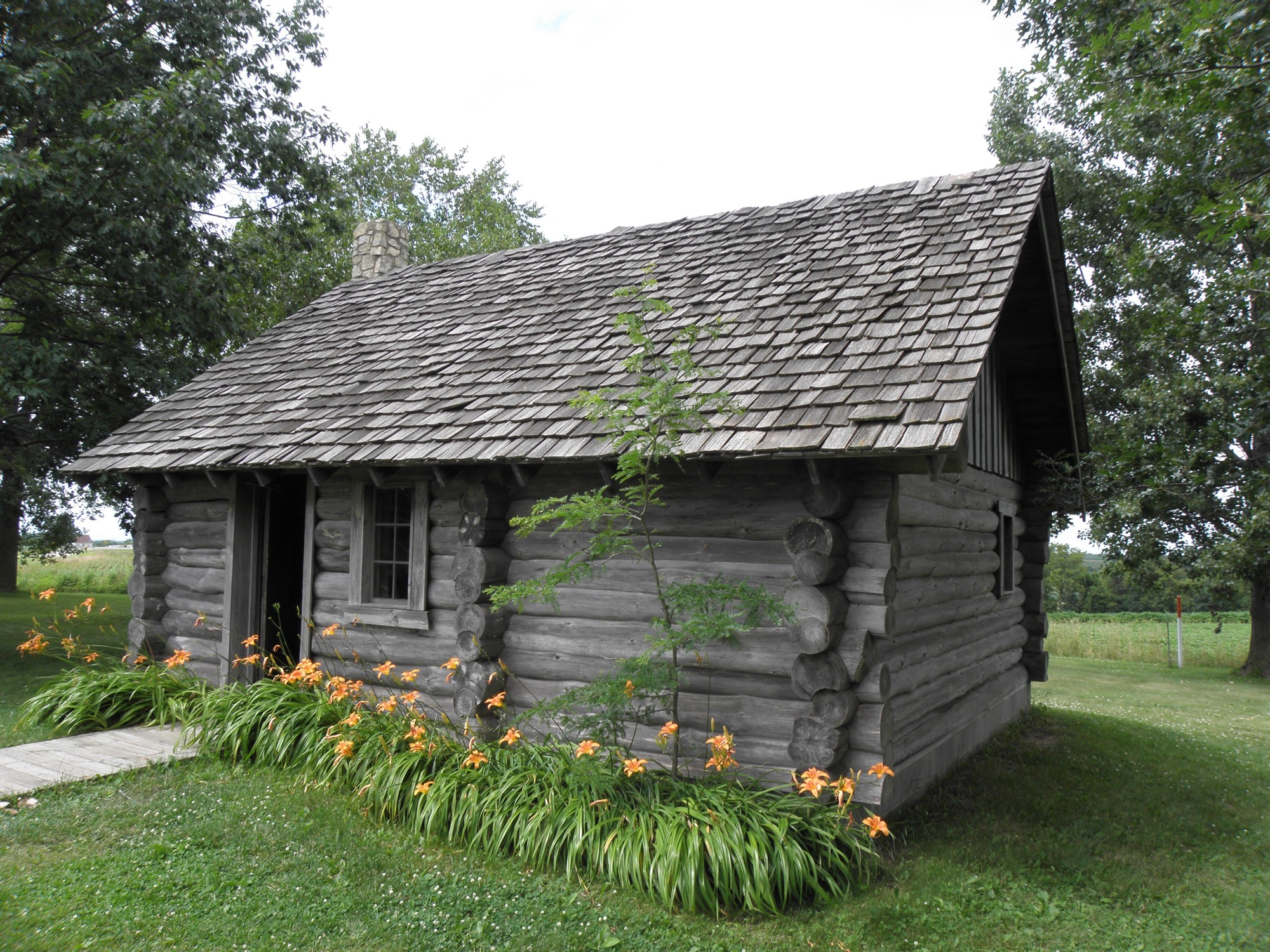 The 1870 s on the move it 39 s a beautiful tree for Building a house in wisconsin