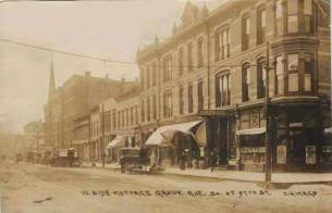 POSTCARD - CHICAGO - COTTAGE GROVE AVE AT 37TH - WAGONS - SIGNS - SEPIA - c1910